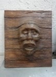 Eerie Face in Wood Panel